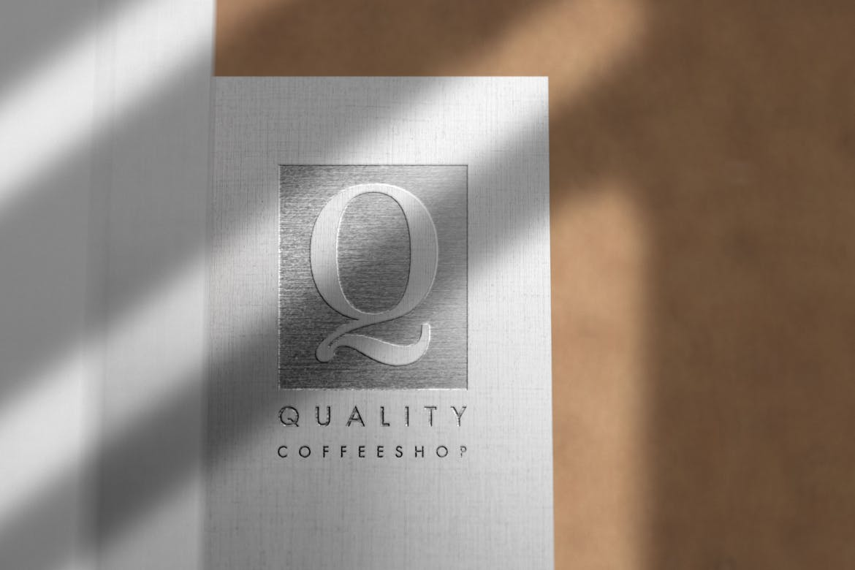 Debossed Silver Logo Mockup on Linen Paper