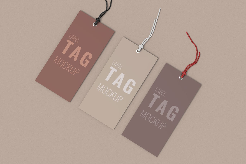 Three Clothes Label Tag Mockup Top Right Angle Vie