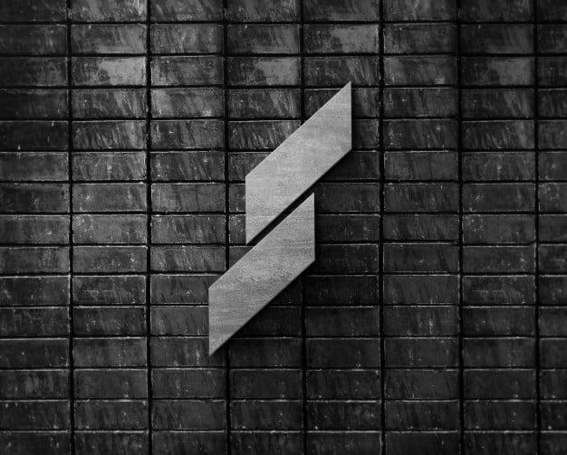 3d logo metal mockup on black brick wall Premium Psd