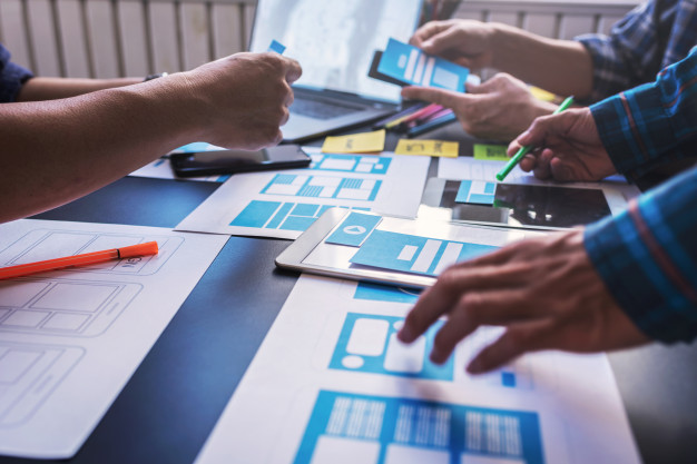 Graphic mobile user experience design teamwork help to design new job in modern office. design workstyle freelance