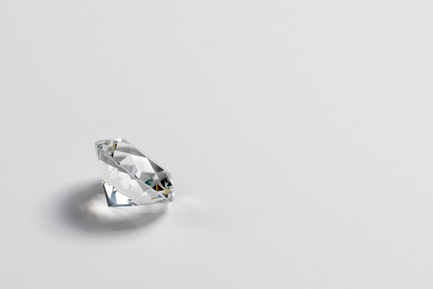 Dazzling diamond on neutral light Premium Photo