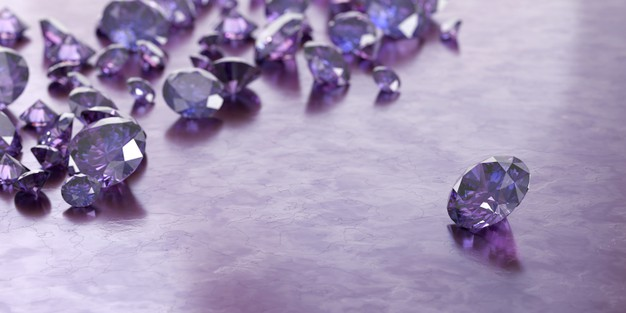 Round purple gems and jewelry diamond groups placed on glossy background Premium Photo