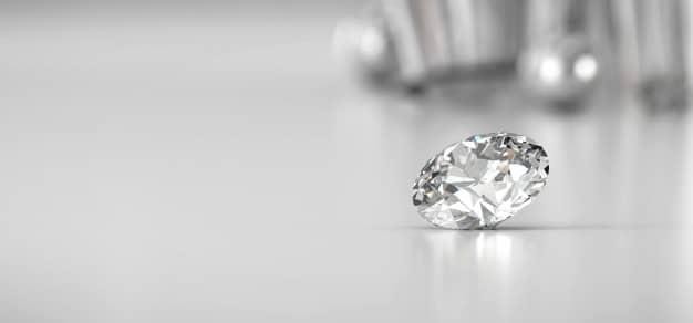 Shiny brilliant diamond placed on gradient background Premium Photo